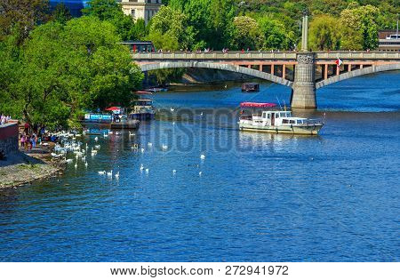Prague/czech Republic- May 4, 2018: Spring Cityscape With Vltava River, Bridge, Touristic Boat, Whit