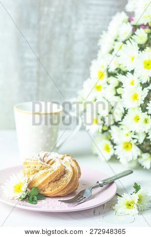 Delicious Cake With Coconut Chips On Pink Plate On White Table, Autumn White Chrysanthemum And Cup O