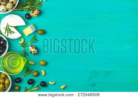 Set Of Cheese Camembert, Black And Green Olives, Quail Eggs On Plates, Olive Oil And Rosemary, On A