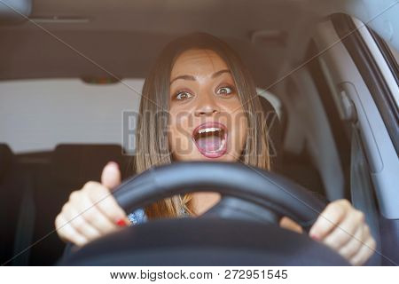 Fright Face Of Woman, Driving Car. Closeup Portrait Displeased Angry Pissed Off Aggressive Woman Dri