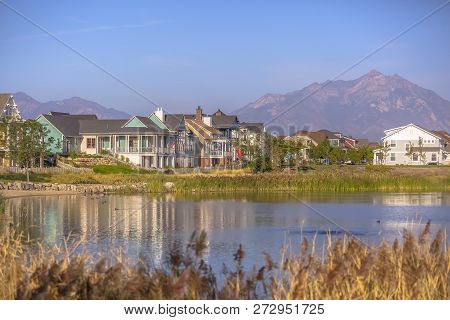 Lakefront Homes Along Oquirrh Lake On A Sunny Day