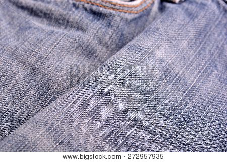 Denim Jeans Background With Seam Of Jeans Fashion Design. Old Grunge Vintage Denim Jean