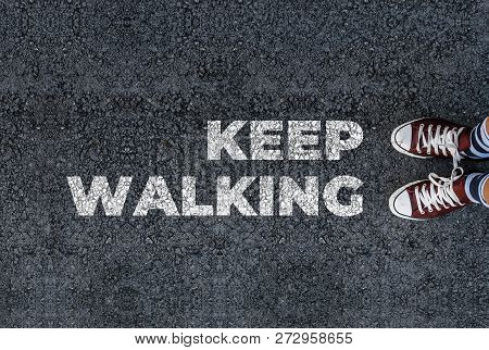 A Man With A Shoes Is Standing Next To Keep Walking On Road Asphalt