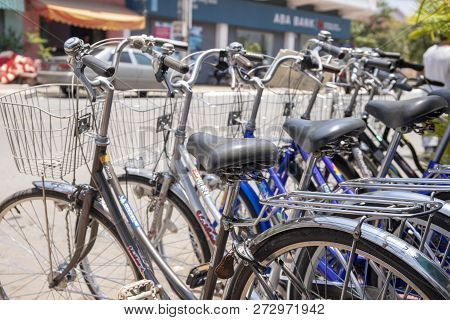 Kampot, Cambodia - 12 April 2018: City Bicycles For Rent Close View, Sunny Street Background. Fresh