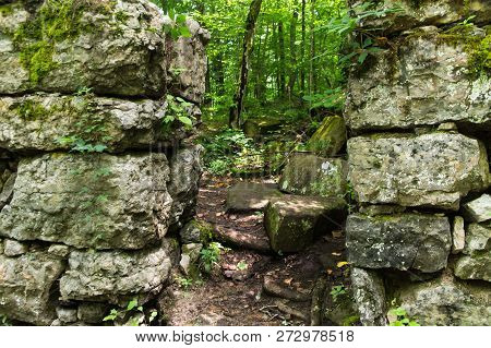A Trail Through An Abandoned Stone Building In A Forest.  Old Stone Fort State Archaeological Park,