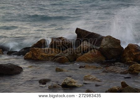 Dreamy Natural Background With Sea Shore, Rocks And Waves. Long Exposure.