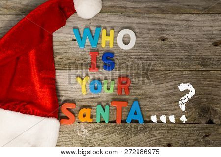 Guess Who Is Your Santa Claus Concept With Colorful Plastic Letters On Wooden Background