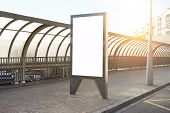Empty billboard placeholder template on the city bus stop, mockup of a blank white advertising urban billboard. poster