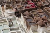 The traditional hand made Leather production in the old City in the historical Town of Fes in Morocco in north Africa. Morocco, Fes, Africa poster