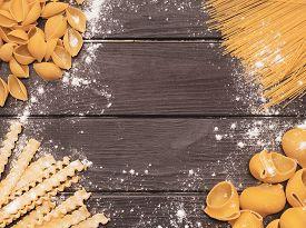 Variety Of Pasta On The Kitchen Wooden Table