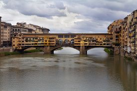 View Of Arno River And Ponte Vecchio Bridge In Florence, Italy.