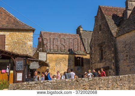 Beynac et Cazenac, France - August 14, 2019:Tourists visiting the medieval town of Beynac et Cazenac in the Dordogne France
