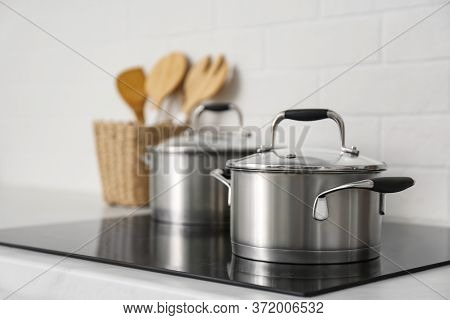 New Saucepots On Induction Stove In Kitchen