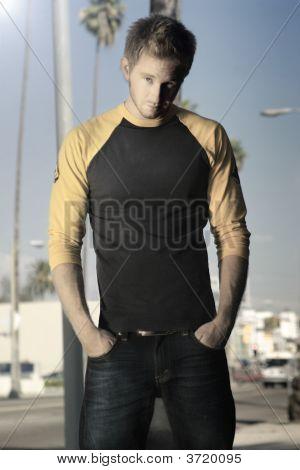 Blond Guy Standing On Sidewalk