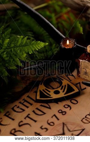 Mystic Ritual With Ouija And Candles. Devil's Board Concept, Black Magic Or Fortune Telling Rite Wit