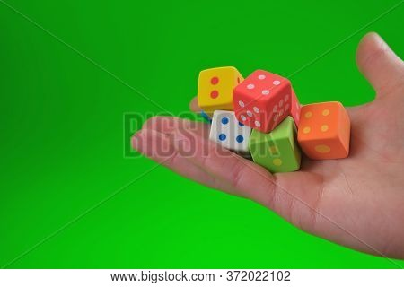 Games Of Chance.gambling Game. Good Luck And Luck.board Games.cubes In A Hand On A Bright Green Back