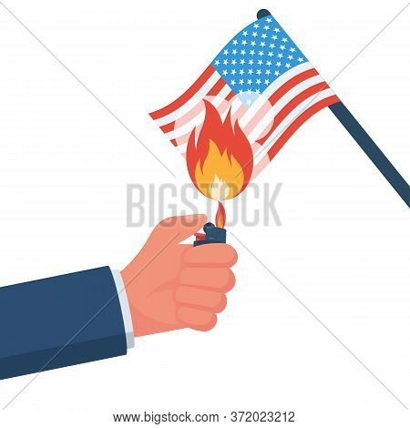 Demonstrator Sets Fire To The American Flag. Usa Flag On Fire. The Symbol Of Protest. A Sign Of Upri