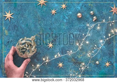Christmas Or New Year Flat Lay Background On Dark Textured Board. Top View Flat Lay On Xmas Garland,