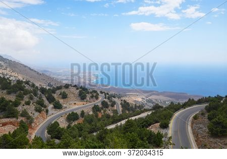 View From The Hill To A Costal Road And Coastline Of Crete On A Bright Day With Mist Over Water, Cov
