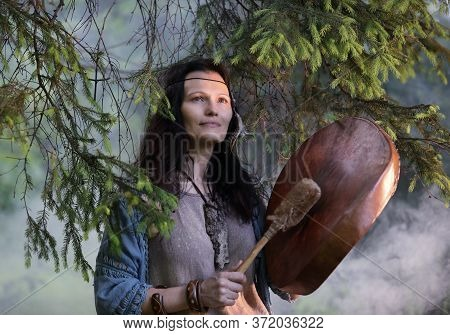 Shaman Woman Playing On Shaman Frame Drum In The Nature