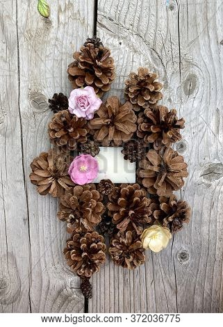 Stylish Wooden Background With Pine Cones, Copy Space For Text. Seasonal Holidays And Spa Concept