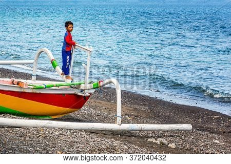 Bali, Indonesia - November 29, 2019: Life In A Fishing Village, Little Boy In A Spiderman Costume On
