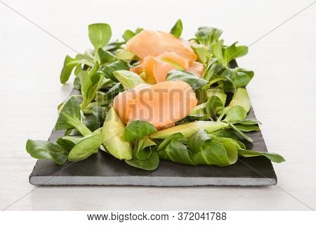 Omega-3 Fatty Acids. Salmon, Avocado And Green Salad On Black Tray.