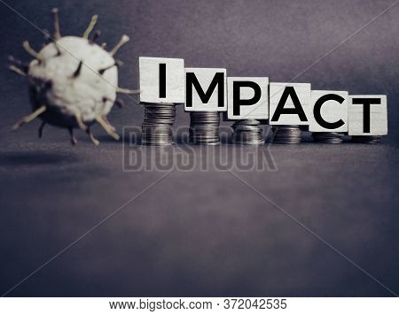 Business, Financial And Economic Concept - Impact Text On Wooden Blocks In Vintage Background. Stock