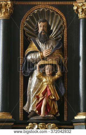 ZAGREB, CROATIA - MAY 16, 2013: Saint Matthew the Evangelist, statue on the pulpit in the Church of Saint Catherine of Alexandria in Zagreb, Croatia