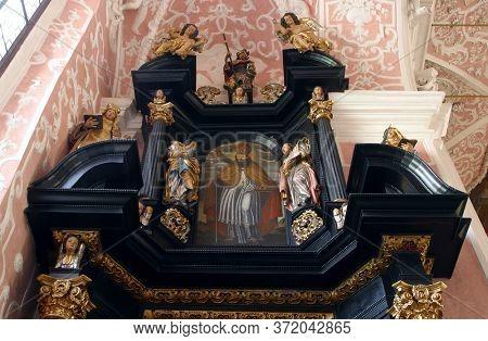 ZAGREB, CROATIA - MAY 16, 2013: Saint Nicholas, altar of Saint Apollonia in the Church of Saint Catherine of Alexandria in Zagreb, Croatia