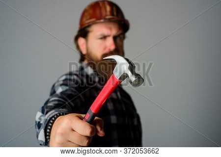 Builder With Hammer. Portrait Of Bearded Workman. Building, Industry, Technology. Builder In Hard Ha