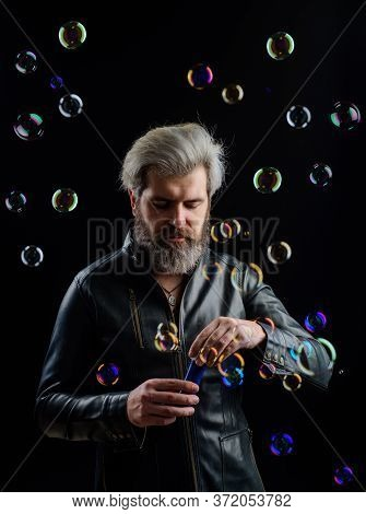 Handsome Man Blowing Bubbles. Soap Bubbles. Play With Bubbles. Bearded Man Blowing Soap Bubbles. Hap