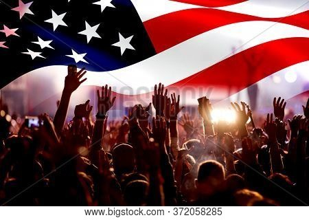 crowd celebrating Independence Day. United States of America USA flag with fireworks background for 4th of July