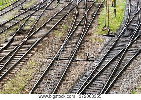 Simple Railway Top View Background. Train Track Texture. Steel Rail On Gravel. Good And Cheap Way Of