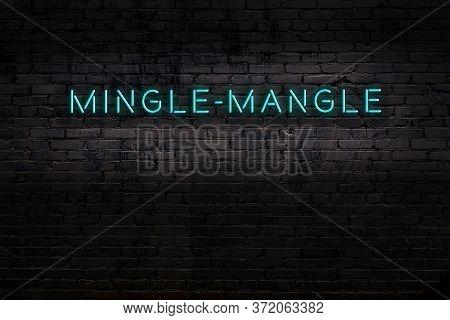 Neon Sign On Brick Wall At Night. Inscription Mingle-mangle