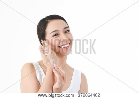 Young Women Apply Nourishing Cream To The Skin On The Back Of The Hand To Be Moist, Not Dry. Concept