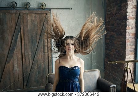 Young Beautiful Girl With Flying Hair. Witch, Magic, Mystery Woman