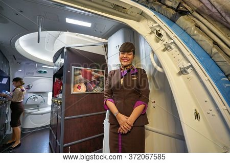 BANGKOK, THAILAND - CIRCA JANUARY, 2020: crew member of Etihad Airways meet passengers. Etihad Airways is the flag carrier of the UAE.