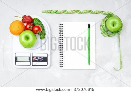 Healthy Weight Loss Meal Plan. Flat Lay Of A Whole Apple Wrapped With Measuring Tape, Kitchen Scales