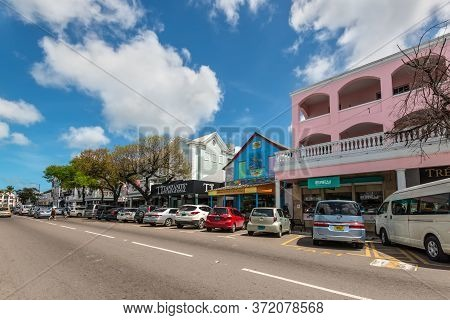 Nassau, Bahamas - May 3, 2019: Street View Of Nassau At Day With Cars Parked Near Tourist Shops In B