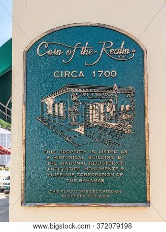 Nassau, Bahamas - May 3, 2019: The Coin Of The Realm Memorial Plate On The Wall In Nassau, Bahamas.