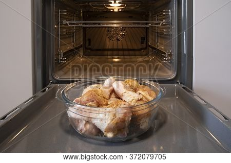 Fresh Chicken Legs In The Oven Before Roasting