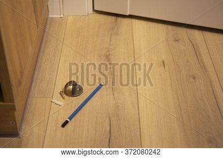 Tools For Door Stopper Instalating In Laminate Floor To Prevent Bumps While Opening Doors.