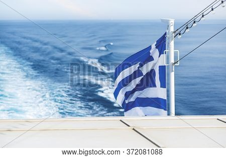 Greek Flag. Travelling By Ferry Among Cyclades Islands, Greece