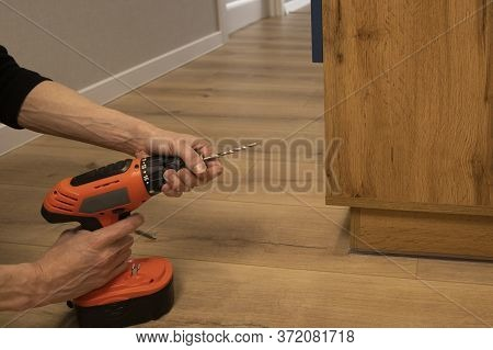 Professional Carpenter Master Working With Screwdriver Indoors