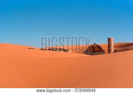 Berber Tents In The Sands Of The Sahara Desert.