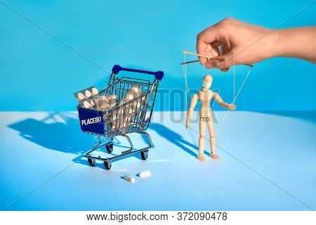 Shopping Cart Full Of Medicines Useless Against Flu And Covid-19 But Very Expensive. Depending On Ph