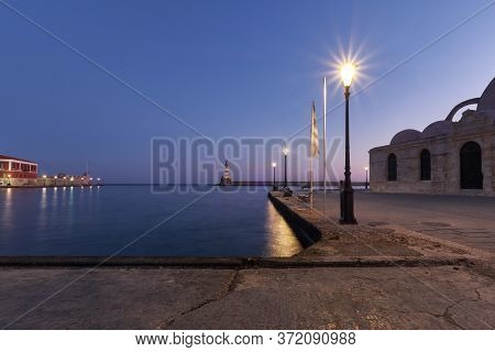 Old Venetian Harbour Xania Creta Greece Towards To The Lighthouse In Twilight, Ancient Lamps In The