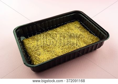 Microgreen Seeds In A Container On A Linen Mat