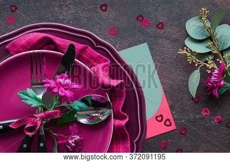 Flat Lay With Burgundy Plates And Crockery Decorated With Burgundy Chrysanthemum, Eucalyptus, Christ